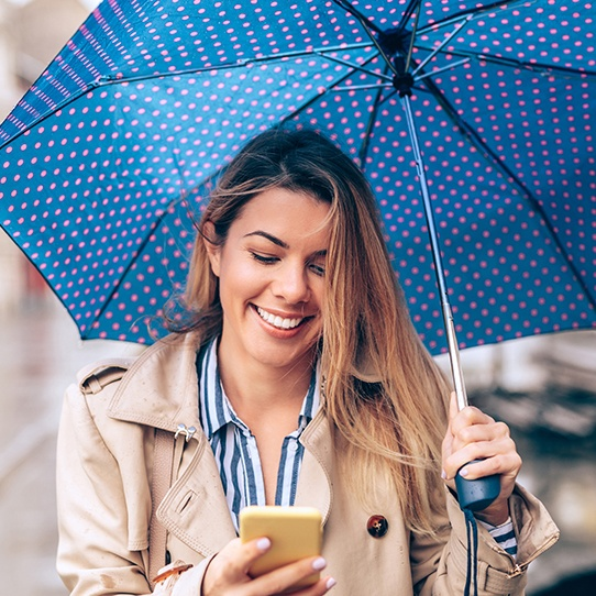 Smiling woman under an umbrella