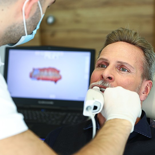 Dentist capturing digital impressions of teeth