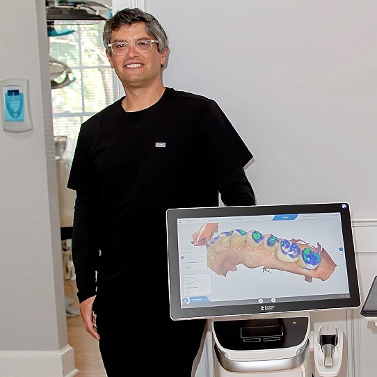 Doctor Graber displaying patient's smile impressions on chairside computer