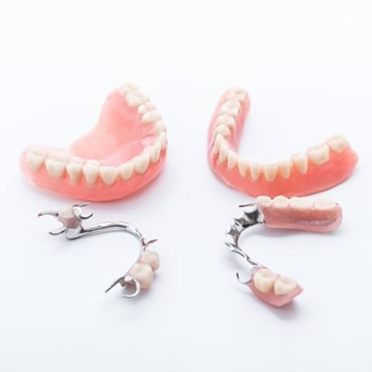 two full dentures and two partials