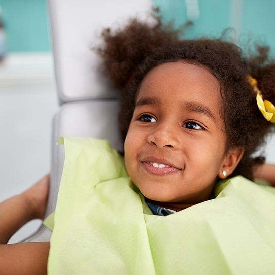 Smiling young girl in office for preventive dentistry checkup
