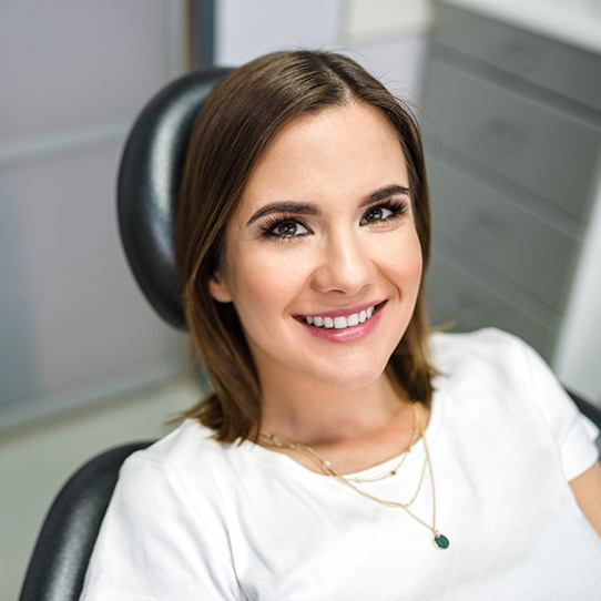 Smiling woman at preventive dentistry checkup visit