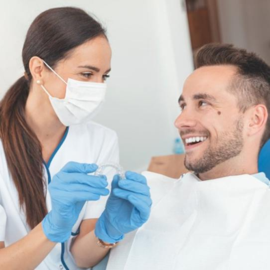 Shelton dentist and patient discussing Invisalign