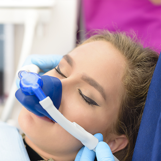 Woman with nitrous oxide dental sedation mask